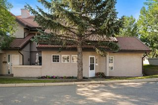 Photo 1: 101 1997 Sirocco Drive SW in Calgary: Signal Hill Row/Townhouse for sale : MLS®# A1142333
