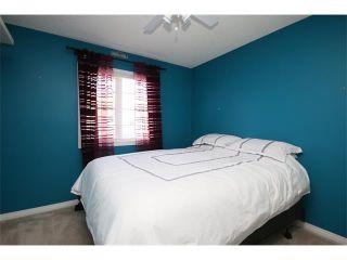 Photo 25: 51 GLENEAGLES View: Cochrane House for sale : MLS®# C4008842