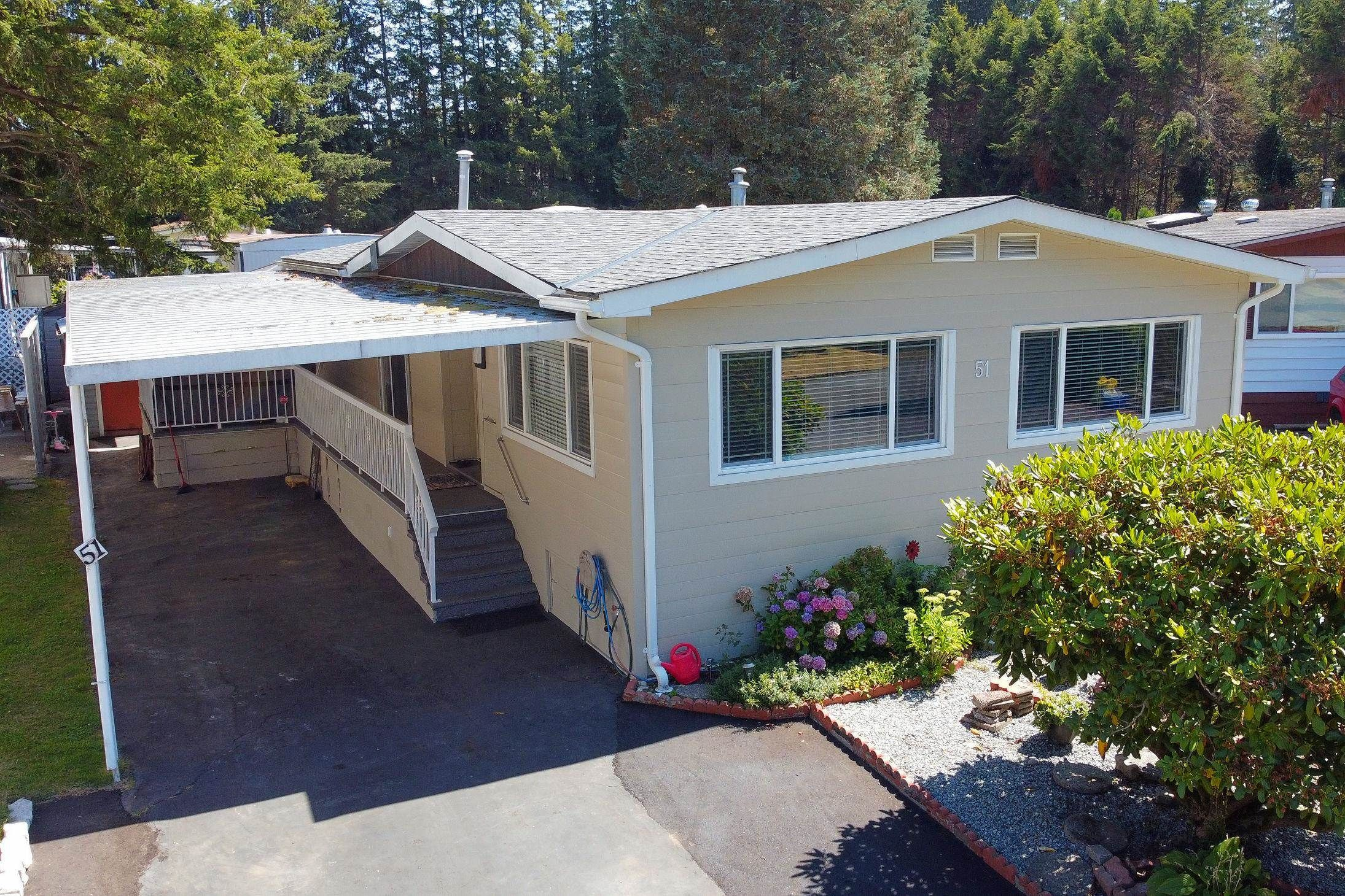 """Main Photo: 51 2305 200 Street in Langley: Brookswood Langley Manufactured Home for sale in """"Cedar Lane"""" : MLS®# R2609129"""