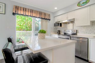 """Photo 2: 28 16388 85 Avenue in Surrey: Fleetwood Tynehead Townhouse for sale in """"Camelot"""" : MLS®# R2474467"""