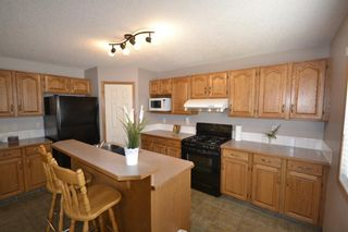 Photo 4: 202 Arbour Stone Rise NW in Calgary: Arbour Lake Detached for sale : MLS®# A1136884