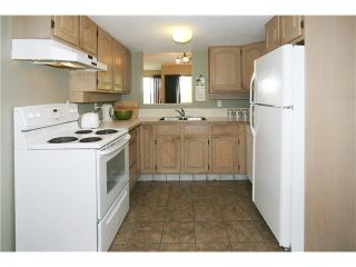 """Photo 4: 557 CARLSEN Place in Port Moody: North Shore Pt Moody Townhouse for sale in """"EAGLE POINT"""" : MLS®# V835962"""