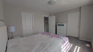 Photo 15: 110 Auburn Meadows Avenue SE in Calgary: Auburn Bay Semi Detached for sale : MLS®# A1095114
