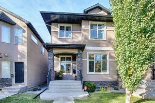 Main Photo: 252 21 Avenue NW in Calgary: Tuxedo Park Semi Detached for sale : MLS®# A1069274