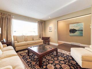 Photo 4: 407 49 Avenue SW in Calgary: Elboya Detached for sale : MLS®# A1060455