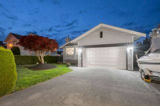 Photo 1: 18863 FORD Road in Pitt Meadows: Central Meadows House for sale : MLS®# R2579235