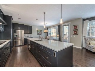 Photo 2: 22 ROCKFORD Road NW in Calgary: Rocky Ridge House for sale : MLS®# C4115282