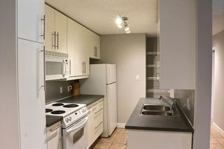 Photo 2: 103 617 56 Avenue SW in Calgary: Windsor Park Apartment for sale : MLS®# A1105822