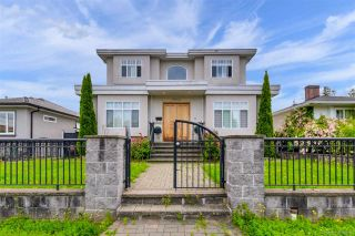 Photo 1: 5534 CLARENDON Street in Vancouver: Collingwood VE House for sale (Vancouver East)  : MLS®# R2535945