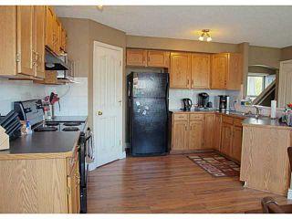 Photo 2: 73 CIMARRON Trail: Okotoks Residential Detached Single Family for sale : MLS®# C3619723
