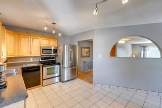 Photo 4: 9 Chisholm Crescent NW in Calgary: Charleswood Detached for sale : MLS®# A1115006