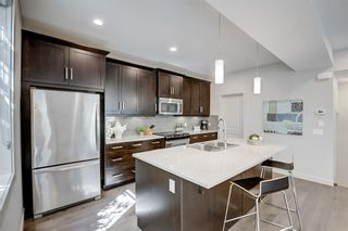 Photo 13: 1 310 12 Avenue NE in Calgary: Crescent Heights Row/Townhouse for sale : MLS®# A1112547