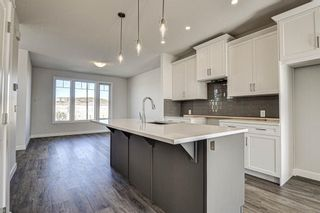 Photo 17: 136 Creekside Drive SW in Calgary: C-168 Semi Detached for sale : MLS®# A1108851