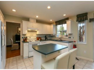 """Photo 8: 7926 REDTAIL Place in Surrey: Bear Creek Green Timbers House for sale in """"Hawkstream"""" : MLS®# F1405519"""