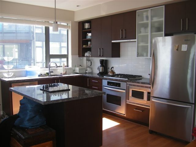 Large, gourmet kitchen with lots of windows