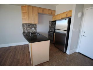 Photo 3: 602 205 Riverfront Avenue SW in Calgary: Chinatown Apartment for sale : MLS®# A1141422