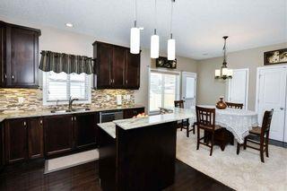 Photo 9: 304 CIMARRON VISTA Way: Okotoks House for sale : MLS®# C4172513