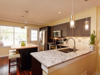 """Photo 4: 8 6651 203 Street in Langley: Willoughby Heights Townhouse for sale in """"Sunscape"""" : MLS®# F1446501"""
