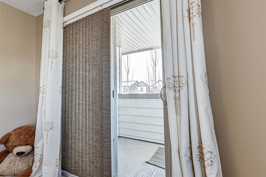 Photo 28: Photos: 230 EVERSYDE Boulevard SW in Calgary: Evergreen Apartment for sale : MLS®# A1071129