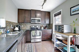 Photo 7: 302 New Brighton Villas SE in Calgary: New Brighton Row/Townhouse for sale : MLS®# A1116930