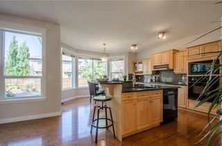 Photo 9: 152 STRATHLEA Place SW in Calgary: Strathcona Park House for sale : MLS®# C4130863