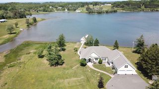 Photo 1: 7815 Pictou Landing Road in Little Harbour: 108-Rural Pictou County Residential for sale (Northern Region)  : MLS®# 202115634