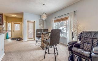 Photo 11: 1401 281 COUGAR RIDGE Drive SW in Calgary: Cougar Ridge Row/Townhouse for sale : MLS®# A1070231