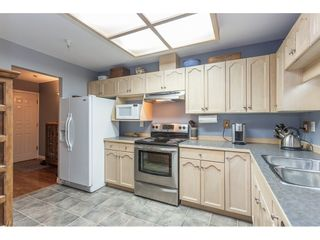 """Photo 3: 212 19241 FORD Road in Pitt Meadows: Central Meadows Condo for sale in """"Village Green"""" : MLS®# R2325248"""