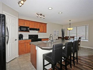 Photo 5: 222 TUSCANY RAVINE Close NW in Calgary: Tuscany House for sale : MLS®# C4046494