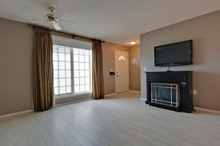 Photo 3: 34 105 Elm Place in Okotoks: Condo for sale : MLS®# C4000778