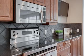 Photo 10: 212 Somme Avenue SW in Calgary: Garrison Woods Row/Townhouse for sale : MLS®# A1129738