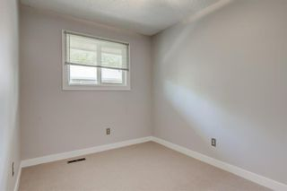 Photo 12: 34 6503 RANCHVIEW Drive NW in Calgary: Ranchlands Row/Townhouse for sale : MLS®# A1018661