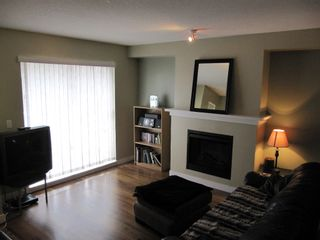 """Photo 2: 100 6747 203RD Street in Langley: Townhouse for sale in """"Willoughby Heights"""" : MLS®# F1107665"""