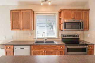 Photo 8: 102 Morris Place: Didsbury Detached for sale : MLS®# A1045288
