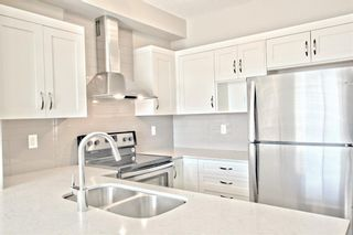 Photo 16: 308 10 WALGROVE Walk SE in Calgary: Walden Apartment for sale : MLS®# A1032904