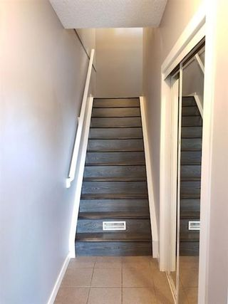 Photo 2: 7 Patina Point SW in Calgary: Patterson Row/Townhouse for sale : MLS®# A1085180