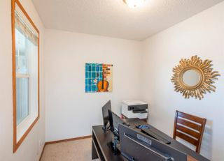 Photo 3: 74 Discovery Heights SW in Calgary: Discovery Ridge Row/Townhouse for sale : MLS®# A1104755
