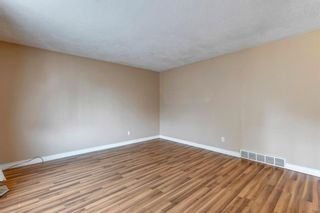 Photo 5: 302 Whitney Crescent SE in Calgary: Willow Park Detached for sale : MLS®# A1146432