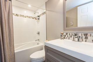 """Photo 24: 107 5909 177B Street in Surrey: Cloverdale BC Condo for sale in """"Carridge Court"""" (Cloverdale)  : MLS®# R2602969"""