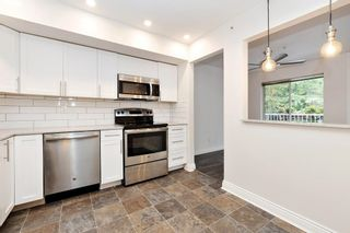"""Photo 12: 113 19236 FORD Road in Pitt Meadows: Central Meadows Condo for sale in """"Emerald Park"""" : MLS®# R2614696"""