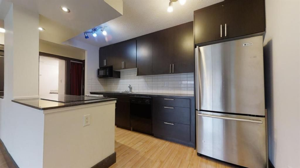 Main Photo: 405 501 57 Avenue SW in Calgary: Windsor Park Apartment for sale : MLS®# A1052996