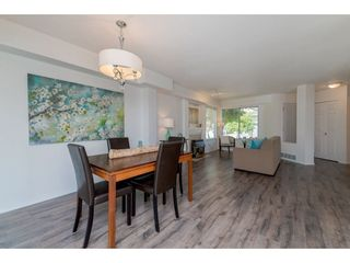 """Photo 6: 210 13900 HYLAND Road in Surrey: East Newton Townhouse for sale in """"Hyland Grove"""" : MLS®# R2295690"""