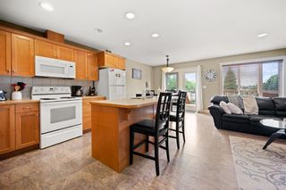 Photo 7: 17 Deer Coulee Drive: Didsbury Semi Detached for sale : MLS®# A1140934