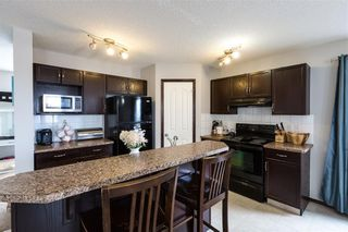 Photo 3: 146 AUTUMN Green SE in Calgary: Auburn Bay Semi Detached for sale : MLS®# C4232262