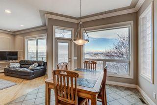 Photo 13: 227 Sunterra Ridge Place: Cochrane Detached for sale : MLS®# A1058667