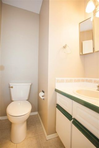Photo 7: 189 CALLINGWOOD Place in Edmonton: Zone 20 Townhouse for sale : MLS®# E4246325