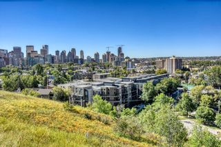 Main Photo: 118 823 5 Avenue NW in Calgary: Sunnyside Apartment for sale : MLS®# A1090115