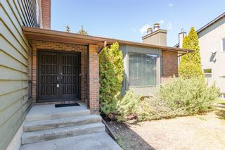 Photo 2: 884 Coach Side Crescent SW in Calgary: Coach Hill Detached for sale : MLS®# A1105957