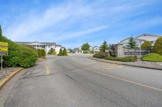 """Photo 1: 166 32691 GARIBALDI Drive in Abbotsford: Abbotsford West Townhouse for sale in """"Carriage Lane"""" : MLS®# R2590175"""