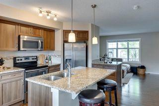 Photo 4: 33 Marine Drive SE in Calgary: Mahogany Row/Townhouse for sale : MLS®# A1124015